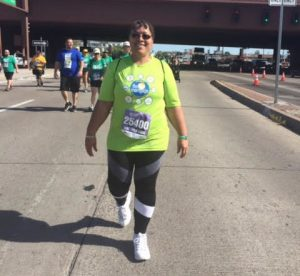 Cancer survivor | Elaine running a 5k race | Urology Associates