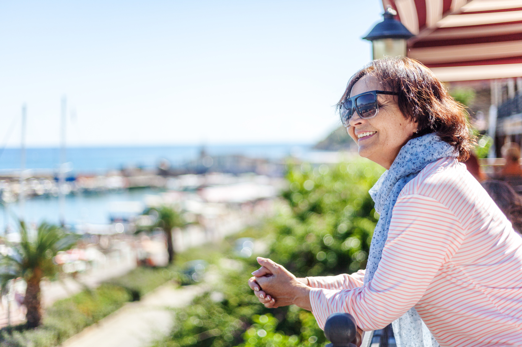 Woman looking at the ocean considering her treatment options for overactive bladder