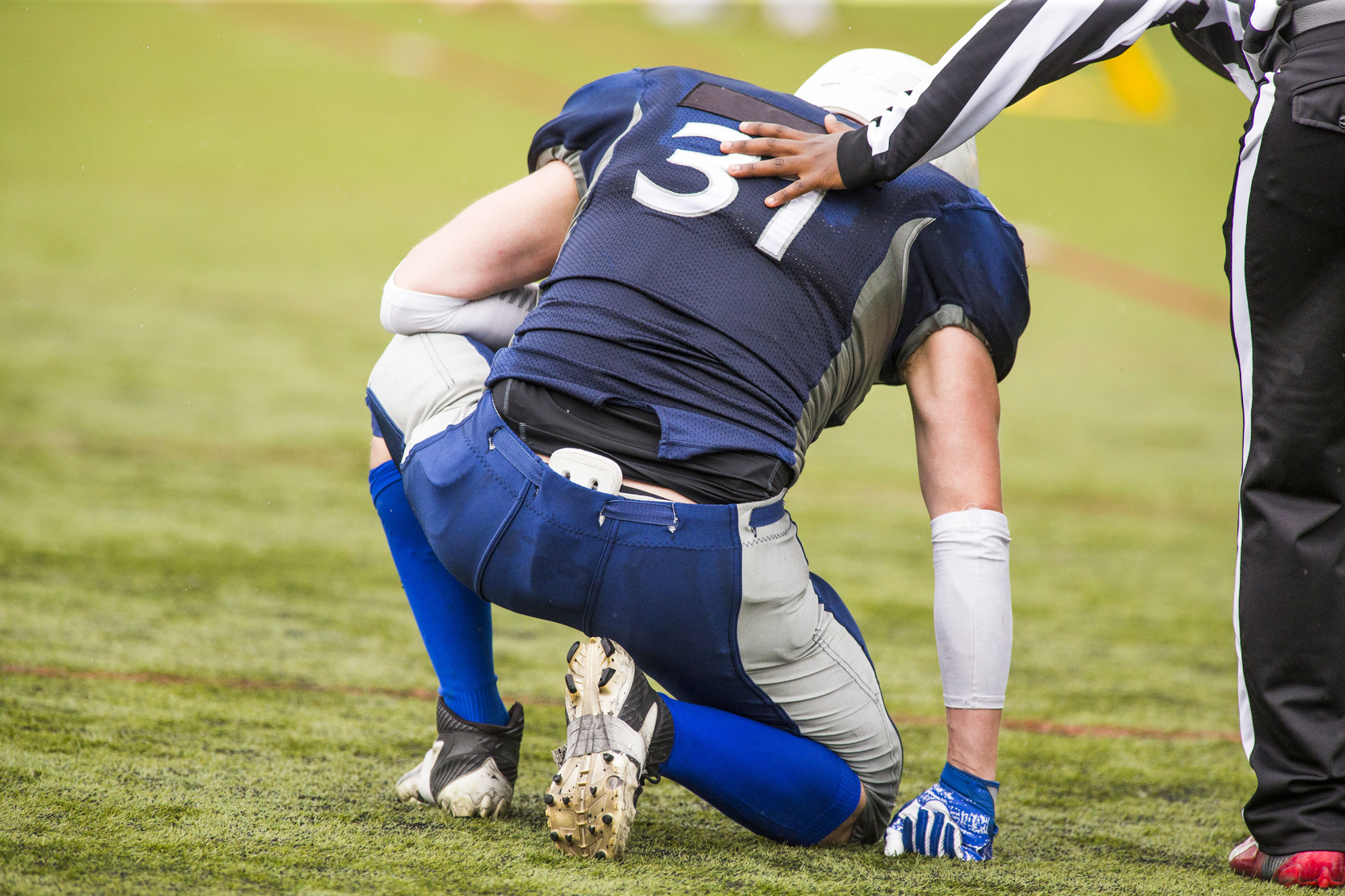 Football playing suffering from testicular pain | Urology Associates | Denver
