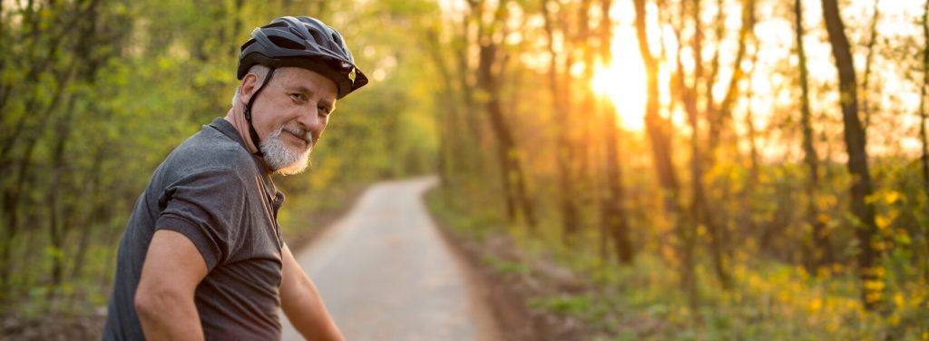 Senior man on his mountain bike outdoors after bladder cancer treatment | Urology Associates | Denver, CO